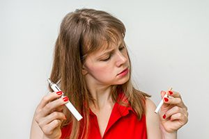 Woman With Cigarette and Vaporizer